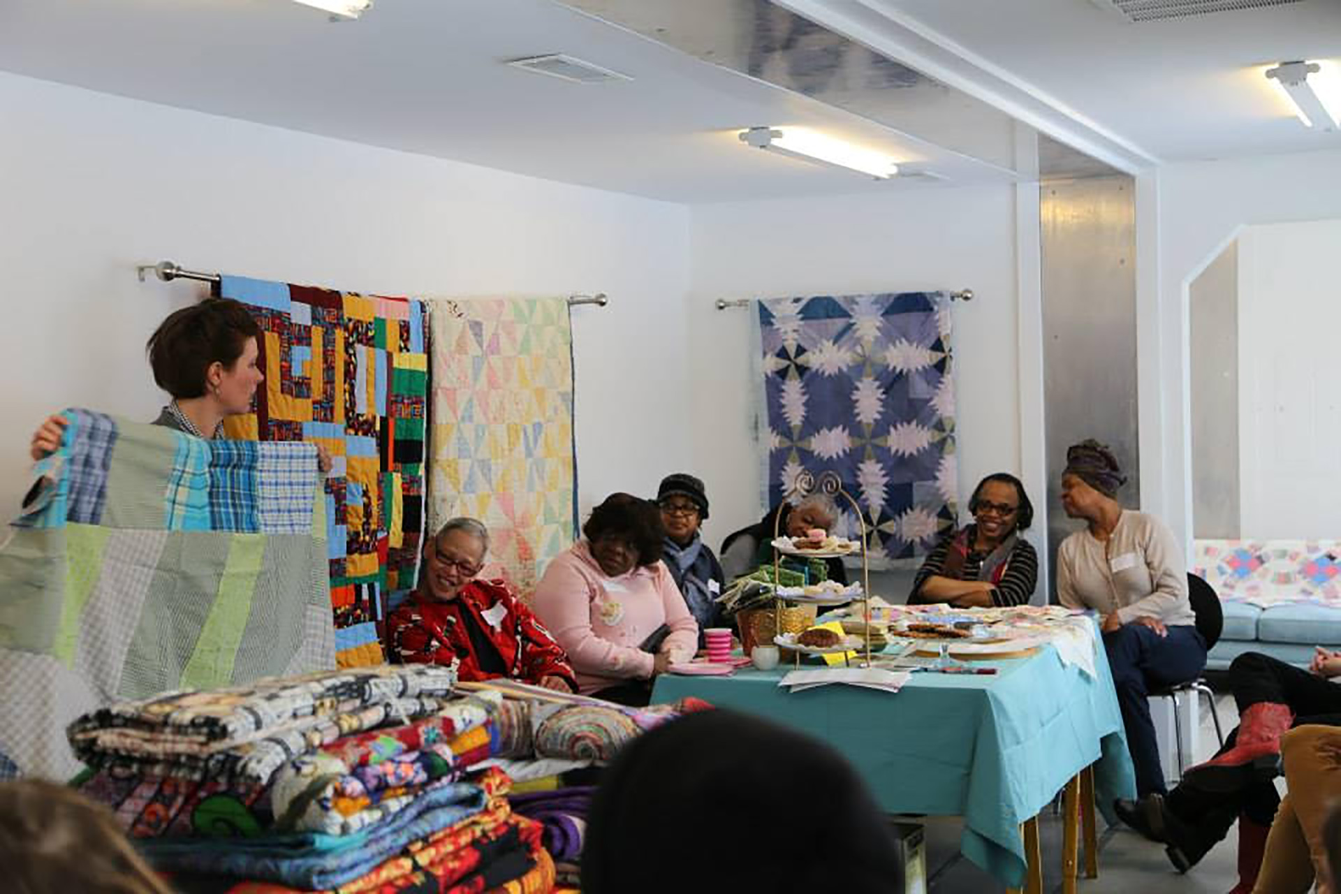 Quilting Bee program inside of the Mobile Homestead, 2014