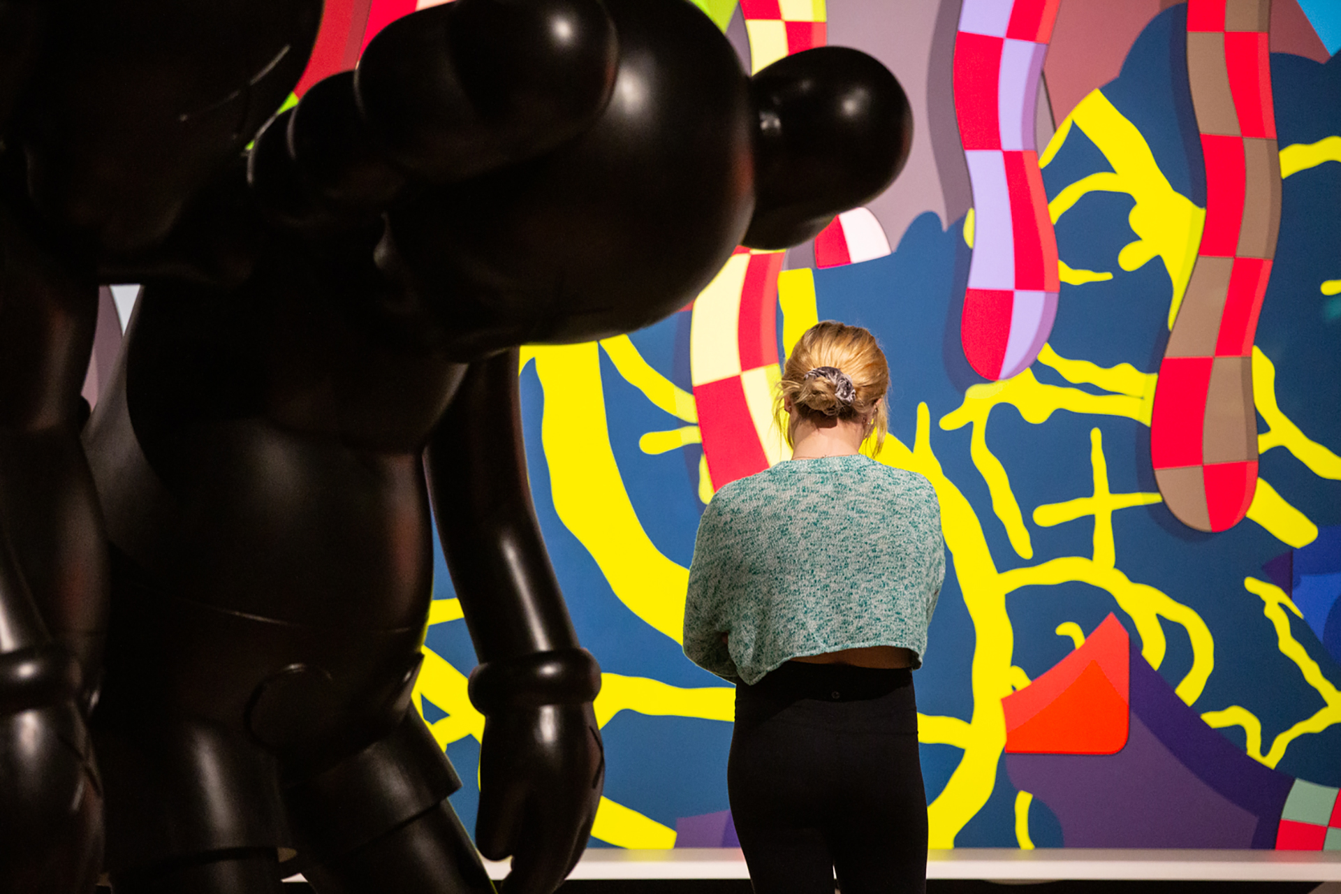 Museum visitor during the exhibition opening of KAWS: ALONE AGAIN, 2019