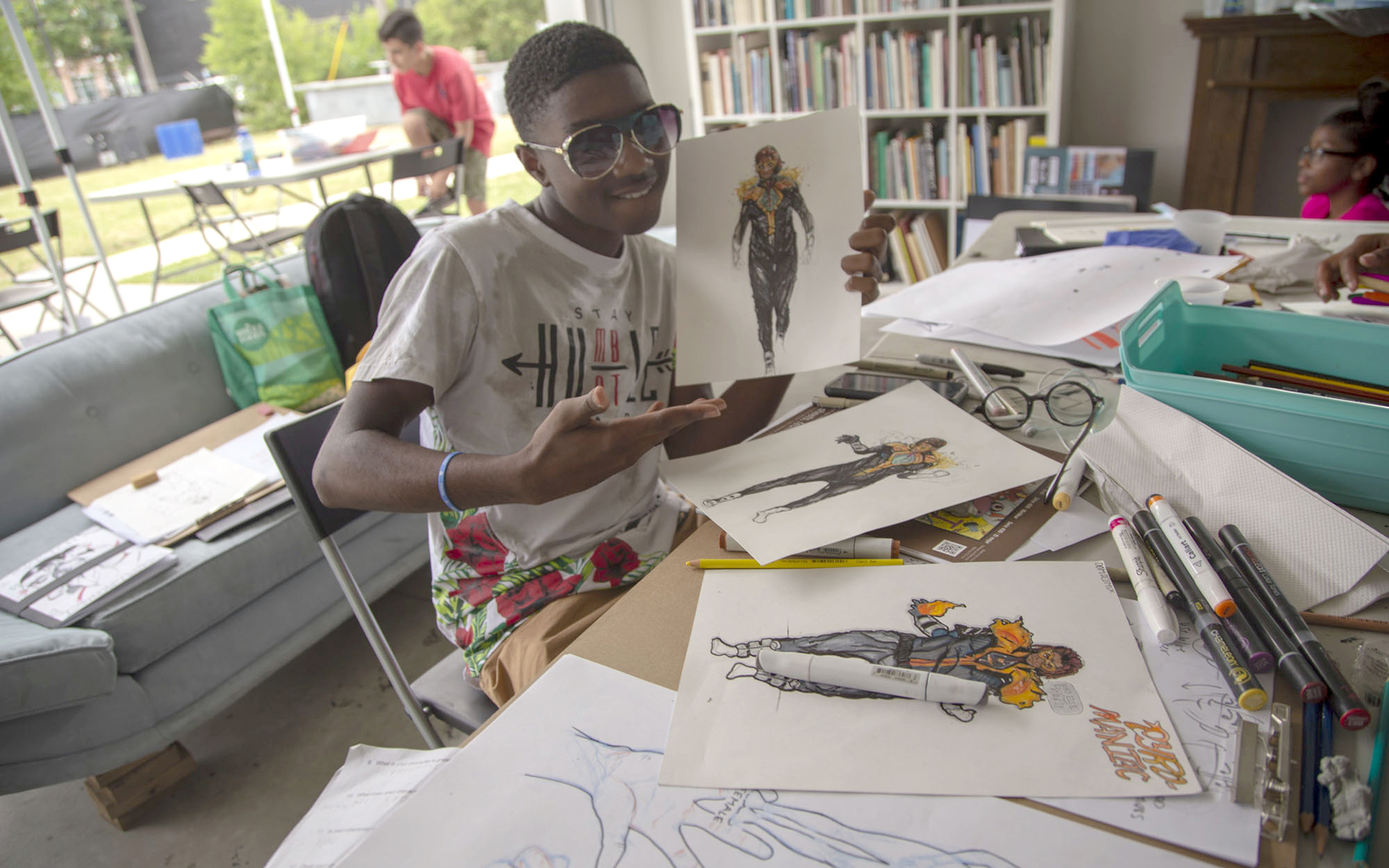 Youth participant in the KAWS EFFECTS: Character Design Summer Camp at MOCAD